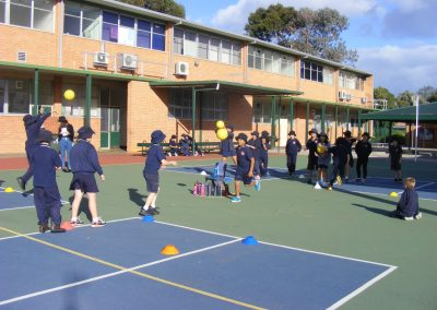 Photo of children playing sports on our court area