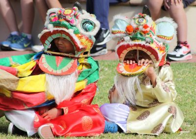 Photo of two children wearing dragon costumes